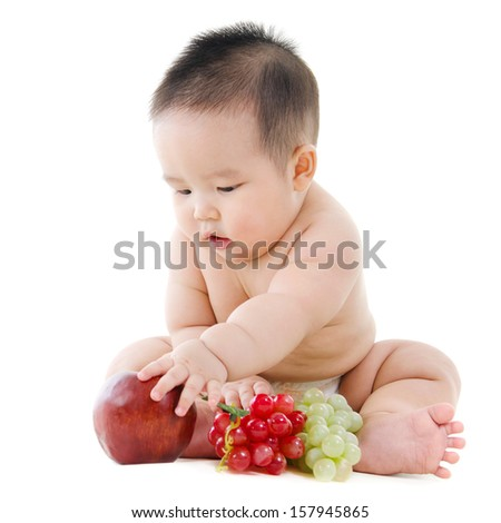 Full body Asian Vegetarian baby playing with fruits sitting isolated on white background
