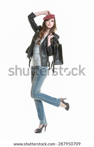 Full body beautiful girl in blue jeans with bag ,hat posing - stock photo