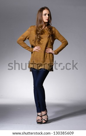 Full body beautiful girl with long hair is in fashion style