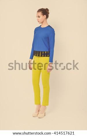 Full body beautiful young woman standing posing retro background - stock photo