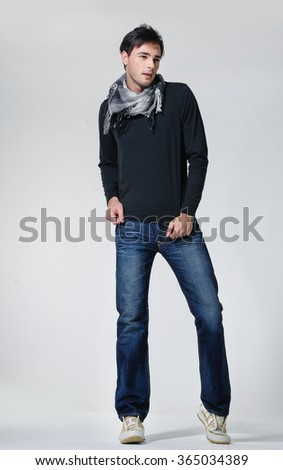 Full body Casual young man standing posing - stock photo