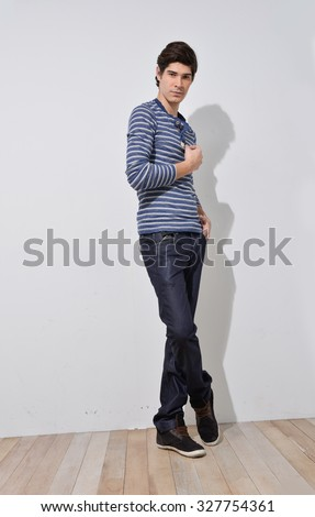 full body confident young man standing isolated. male model.