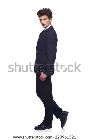 Full body elegant smiling business man walking, over white background.