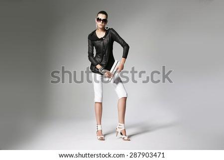 Full body fashion model posing in studio - stock photo