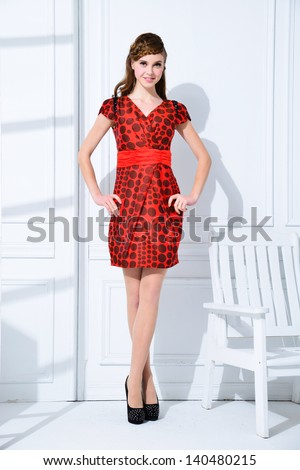 Full body fashion model with ladder, chair posing