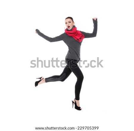 Full body fashion model with scarf jumping on white background - stock photo