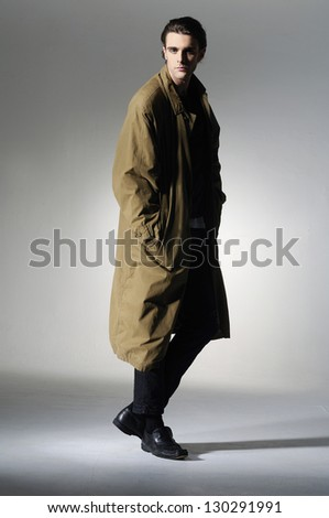 Full body fashion Shot of a young man in coat- professional model.