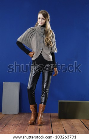 full body fashion woman posing on wooden floor in studio - stock photo