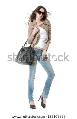 Full body Girl in jeans with sunglasses , posing standing isolated - stock photo
