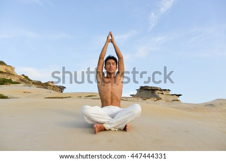 full body handsome man doing yoga exercise in outdoors - stock photo