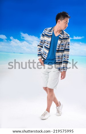 Full body Handsome young man walking at beach background - stock photo
