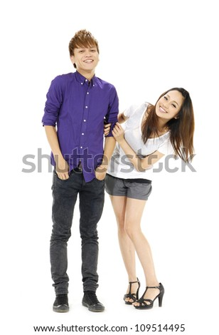 Full body happy young couple posing