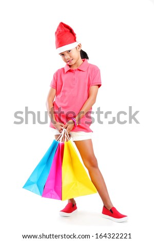 Full body image of a young asian girl with shopping bag. Isolated in white background. - stock photo