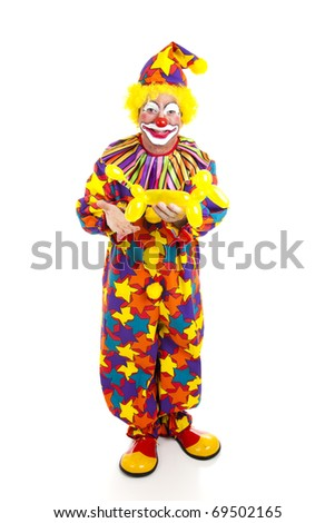 Full body isolated view of a birthday clown holding a balloon animal. - stock photo