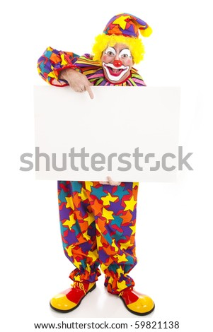Full body isolated view of a friendly circus clown holding a black white sign. - stock photo