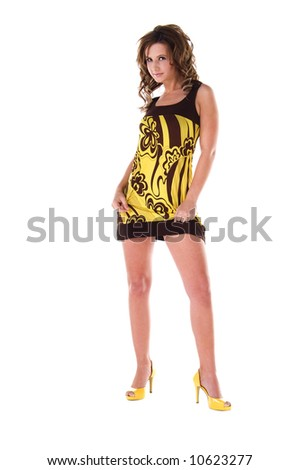 Full body isolation of a young female model in a bold floral print mini dress - stock photo