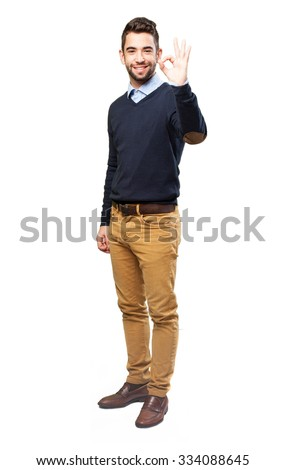 full body man doing an okay gesture - stock photo