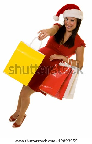 Full body of a Hispanic woman in red dress and santa hat holding colorful packages over white