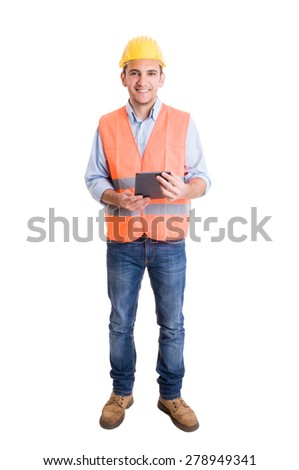 Full body of a modern engineer on white background holding a wireless tablet - stock photo