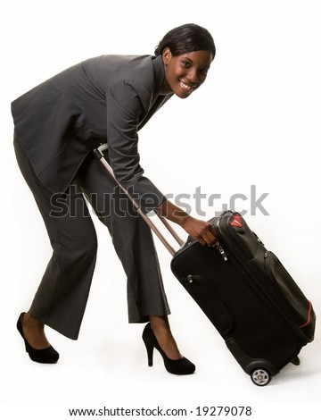 Full body of African American woman in grey business suit bending over to open suitcase - stock photo