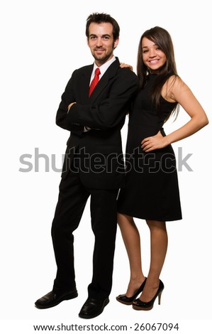 Full body of an attractive brunette woman wearing black formal dress and man in suit and red tie standing beside each other over white - stock photo