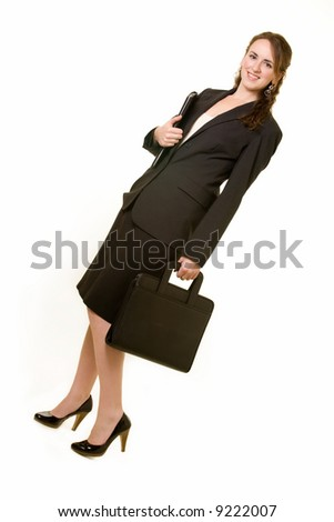 Full body of an attractive young brunette business woman wearing black business suit and holding a briefcase on white