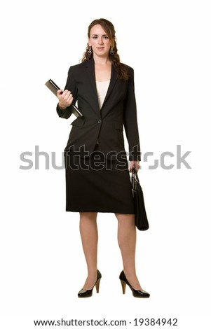 Full body of attractive brunette woman wearing black business suit with skirt standing over white - stock photo