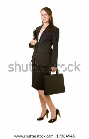 Full body of attractive brunette woman wearing black business suit with skirt standing over white