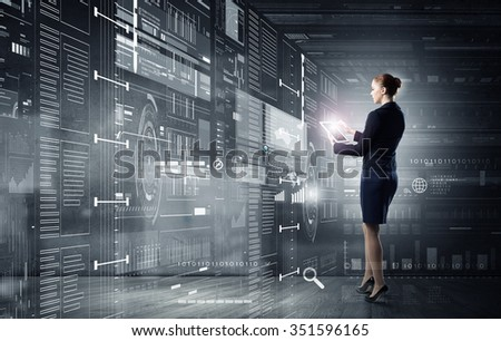 Full body of businesswoman with tablet pc against high tech background - stock photo