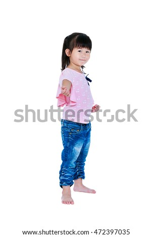 Full body of happy asian child posing in the studio, isolated on white background. Playful girl smiling and looking at camera. Studio shot.
