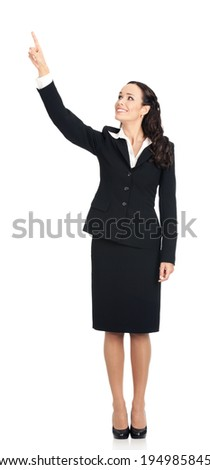 Full body of happy smiling young beautiful business woman showing up on something or copyspase for product or sign text, isolated over white background