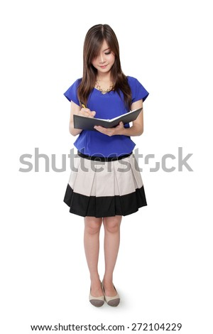 Full body of young Asian woman standing and writing on notebook, isolated on white background - stock photo