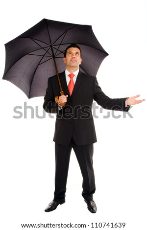 Full body of young business man with umbrella and checking the rain on white
