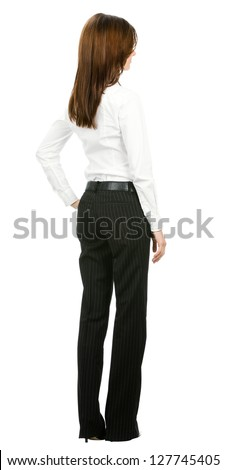 Full body of young business woman looking at something, from the back, isolated on white background - stock photo