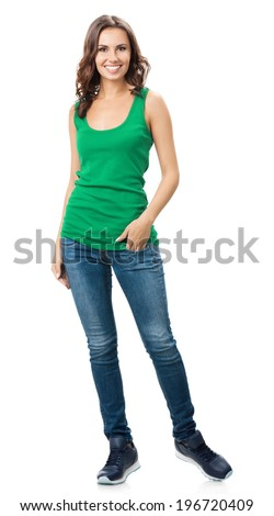 Full body of young cheerful smiling woman in smart green casual clothing, isolated over white background - stock photo