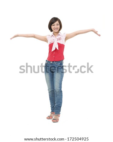 Full body oung woman looks at her open palm - stock photo