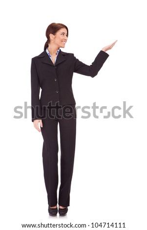 full body picture of a business woman presenting something imaginary over white background - stock photo