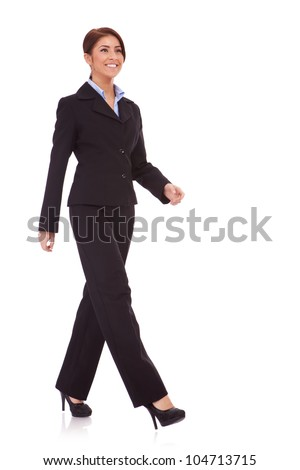 full body picture of a business woman walking isolated over a white background - stock photo