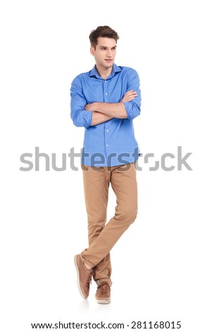 Full body picture of a casual young man standing with his hands crossed on idolated background. - stock photo