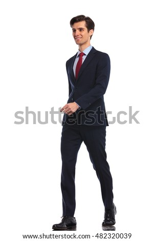 full body picture of a happy smiling young business man walking forward , isolated on white background