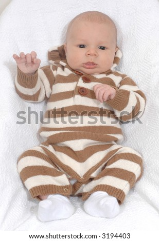 Full body portrait of a baby boy.  He is five weeks old. - stock photo