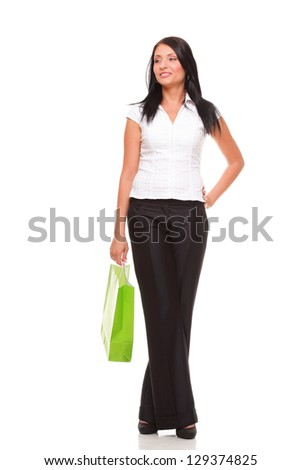 Full body portrait of a cheerful businesswoman holding shopping bags. Concept of commerce and finance in business. Isolated on white - stock photo
