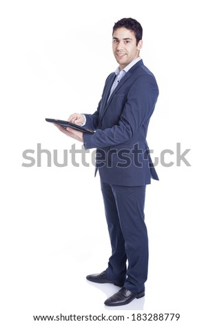 Full body portrait of a handsome business man using a tablet pc, isolated on white - stock photo