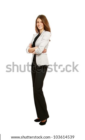 Full-body portrait of a happy business woman looking at camera with arms folded. Isolated on white background