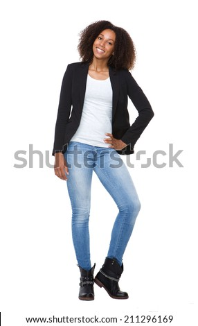 Full body portrait of a modern young woman smiling on isolated white background - stock photo
