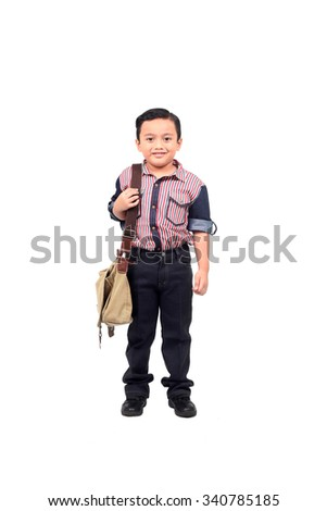 Full body portrait of a smiling young boy kid with sling bag - stock photo