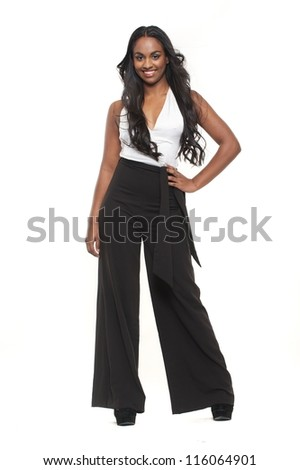 Full body portrait of a young woman smiling against white background - stock photo