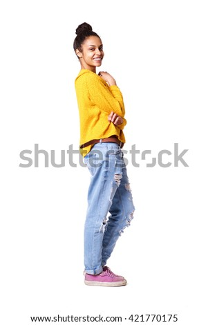 Full body portrait of attractive young african american woman standing on white background - stock photo