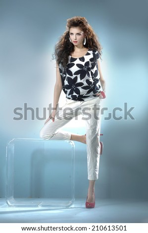 Full body Portrait of beautiful casual young fashion model shot in studio - stock photo