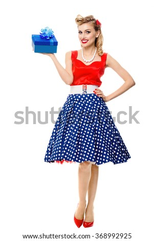 Full body portrait of beautiful young happy smiling woman dressed in pin-up style dress with polka dot, isolated. Caucasian blond model posing in retro fashion and vintage concept studio shoot. - stock photo